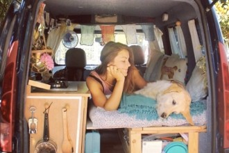 A woman takes her dog on a road trip